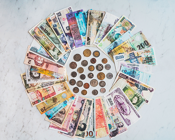 Different currencies of money spread into a uniform circle