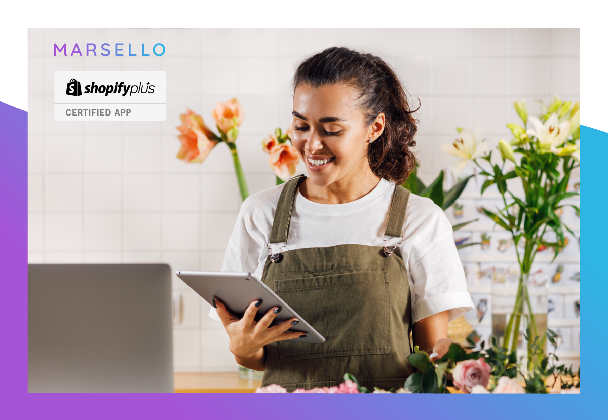Woman using at IPad from behind a shop counter with purple and blue marsello brand colours bordering the image.