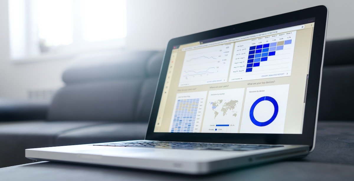 MacbookPro with an insights and data dashboard displaying results on the screen.