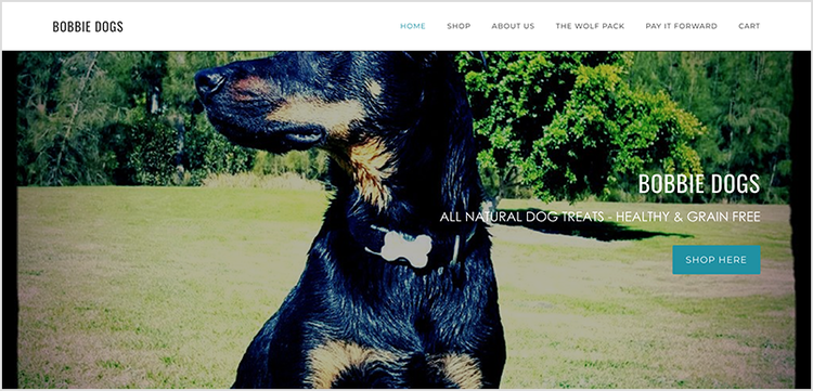 Bobbie Dogs website homepage with a large banner image of a black and tan dog.